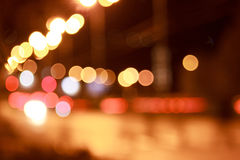 Bright lights of the night streets. Bright lights of the night streets with bokeh effect Royalty Free Stock Photos