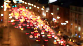Bright lights of night traffic of the avenue in Moscow. Out of focus view at evening city prospect traffic, Moscow, Russia stock video footage