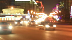 Bright lights of night traffic of the New Arbat avenue in Moscow. Out of focus view at evening former Kalininsky prospect traffic, Moscow, Russia stock video footage
