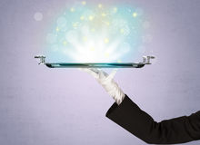 Bright lights presented on tray by waiter Stock Image