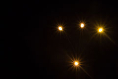 Bright lights with rays on a dark background. Blurring on a dark background Stock Photography