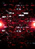 Bright lights on red brick wall background Royalty Free Stock Photography