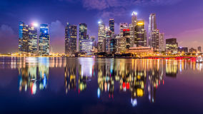 The bright lights of Singapore city as seen from across the marina Royalty Free Stock Photos