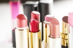 Bright lipsticks  on white background Stock Images