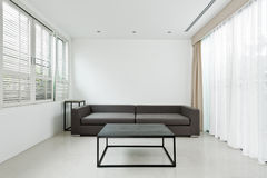 Bright Living room with grey sofa Stock Photos