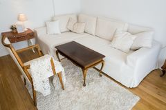 Bright living room with sofa and vintage decor royalty free stock photos
