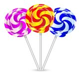 Bright lollipops on a white background Royalty Free Stock Image