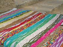 Bright long beads are sold on the market.  royalty free stock photography