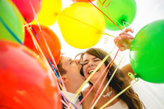 Bright love. Cheerful young wedding couple holding Royalty Free Stock Photos