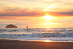 Bright luminous early sunset over Rocky outcrops on Oregon Coast Royalty Free Stock Photos