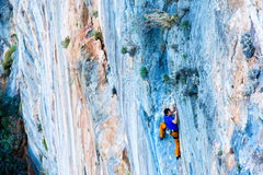 Bright luminous orange blue Rock pattern and Climber Stock Photography