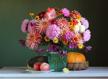 Bright lush bouquet of garden flowers. empty space for your text. Bright lush bouquet of garden flowers on the chair. empty space for your text stock photo