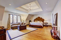 Bright luxury bedroom with design ceiling Stock Photography