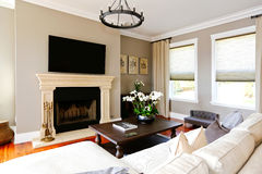 Bright luxury living room with fireplace and tv Royalty Free Stock Photo
