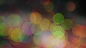 Bright magic colorful bokeh effect as background. Stock footage. Abstract blurred colored lights
