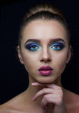 Bright make-up on for a beautiful photo models. Professional make-up for a very beautiful blue-eyed model Royalty Free Stock Photography