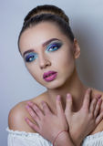 Bright make-up on for a beautiful photo models. Professional make-up for a very beautiful blue-eyed model Stock Photos