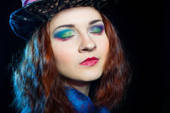 Bright make-up of young woman in the similitude of the Hatter. (Alice's Adventures in Wonderland stock image