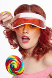 Bright makeup. Beauty Girl Portrait holding Colorful lollipop. P Royalty Free Stock Image