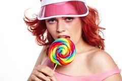 Bright makeup. Beauty Girl Portrait holding Colorful lollipop. P Stock Photo