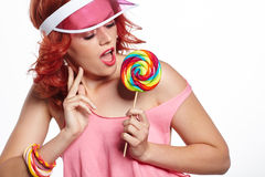 Bright makeup. Beauty Girl Portrait holding Colorful lollipop. P. Bright makeup. Girl Portrait holding Colorful lollipop. Pink cap stock image