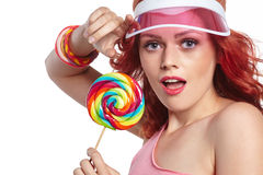 Bright makeup. Beauty Girl Portrait holding Colorful lollipop. Royalty Free Stock Photography