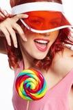 Bright makeup. Beauty Girl Portrait holding Colorful lollipop. Stock Photos