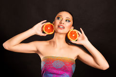 Bright makeup. Girl with Orange. Beautiful, playful girl with oranges Stock Photography
