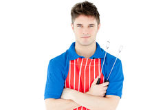 Bright man holding cookware looking at the camera Stock Images