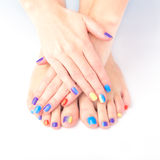 Bright manicure and pedicure. Bright hands with manicure feet with pedicure royalty free stock photo