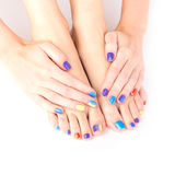 Bright manicure and pedicure. Young woman hands and feet with bright manicure and pedicure stock photo