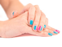 Bright manicure woman hands close up on white  Royalty Free Stock Image