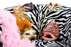 Bright masquerade masks on retro chair Royalty Free Stock Photography