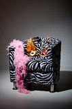 Bright masquerade masks on retro chair Stock Photography