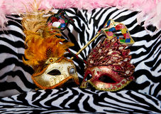 Bright masquerade masks on retro chair Royalty Free Stock Image