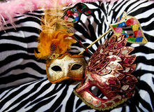 Bright masquerade masks on retro chair. Image shoeing brightly coloured masquerade masks on retro style chair royalty free stock photo