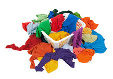 Bright messy clothes in a laundry basket Royalty Free Stock Photo