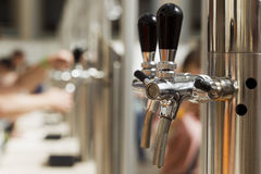 Bright metal beer tap. Natural light, sunlight Stock Photography