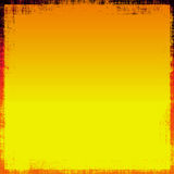Bright Metallic Grunge. Orange and yellow bright tones metallic grunge abstract background with border Royalty Free Stock Image