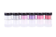 Bright mineral eye shadows in clear plastic jars Royalty Free Stock Images