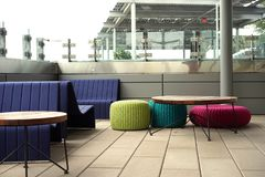 Bright modern deck seating pops Stock Photos