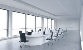 A bright modern panoramic meeting room in a modern office with white copy space in windows. The concept of the meeting of the Boar. D of Director of the huge Royalty Free Stock Images