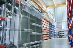 Bright modern Warehouse Storage with Workers commissioning in motion Bluer. A bright and modern Warehouse with Workers commissioning with Carts in motion Bluer stock images