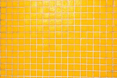 Bright mosaic background. Yellow holografic texture. Bright mosaic background. Yellow holografic texture close up. Holografic squares Stock Photography