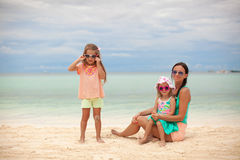 Bright mother and two her kids at exotic beach on. Sunny day. This image has attached release Stock Photos