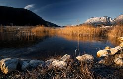 Bright mountain peaks reflection in morning lake, majestic highlands landscape stock image