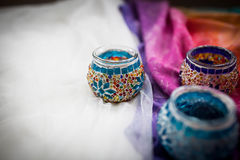 Bright multi-colored candleholders handmade stock photo