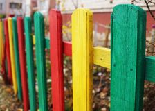 Bright multi-colored fence kindergarten royalty free stock photo