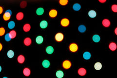 Bright multi-colored light blurs. Over black background Royalty Free Stock Images
