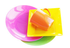 Bright multi colored plastic dishware Stock Photography